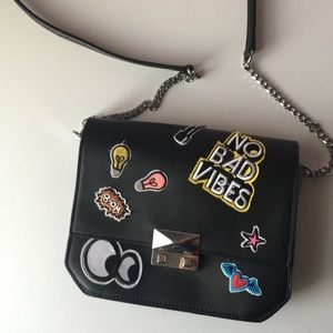 Patched crossbody bag